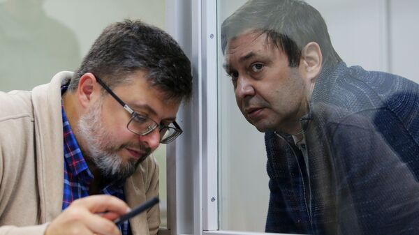 Адвокат Андрей Доманский и руководитель портала РИА Новости Украина Кирилл Вышинский