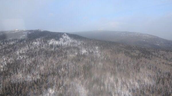 Вид с вертолета на район поиска туристок в окрестностях горы Казанский камень, Ввердловская область. 21 января 2019