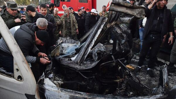 На месте взрыва заминированного автомобиля марки Suzuki на площади аль-Хамам в Латакии. 22 января 2019