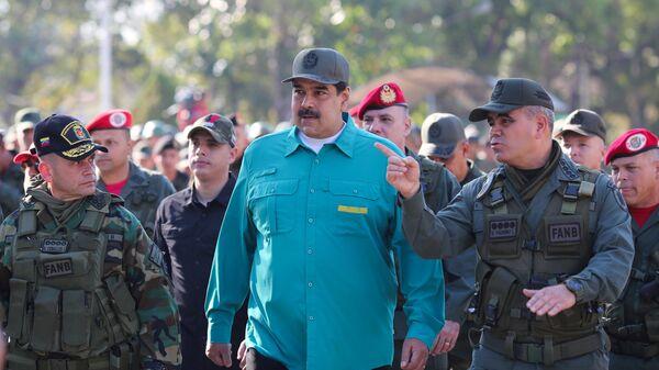Президент Венесуэлы Николас Мадуро во время военных учений