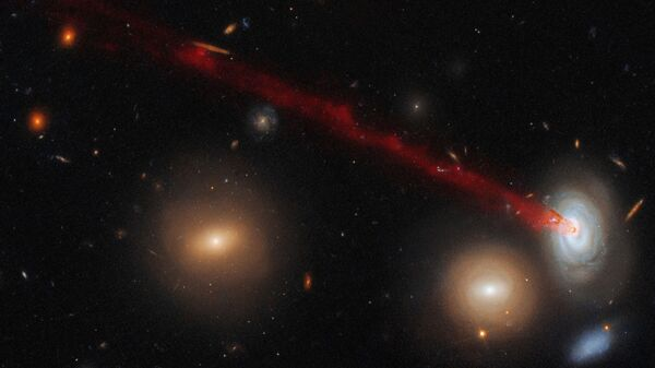 Длинный газовый хвост cпиральной галактики D100