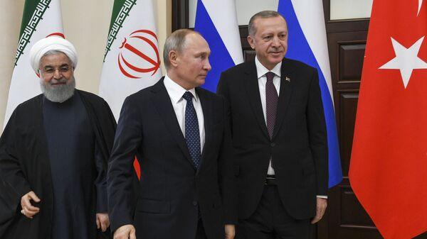 Президент РФ Владимир Путин с президентом Исламской Республики Иран Хасаном Рухани и президентом Турецкой Республики Реджепом Тайипом Эрдоганом в Сочи