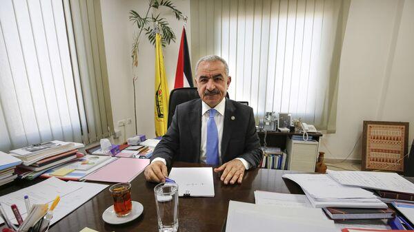 Новый премьер-министр Палестины Мухаммед Штайе в своем офисе в Рамалле. 10 марта 2019