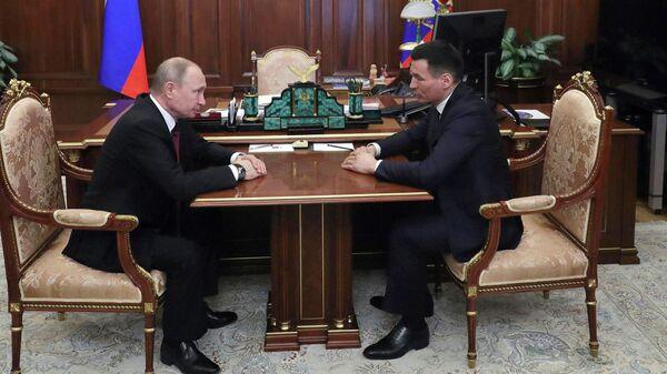 Президент РФ Владимир Путин во время встречи с Бату Хасиковым. 20 марта 2019