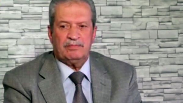 Стоп-кадр передачи с участием члена Национального Палестинского совета Наджиба аль-Каддуми