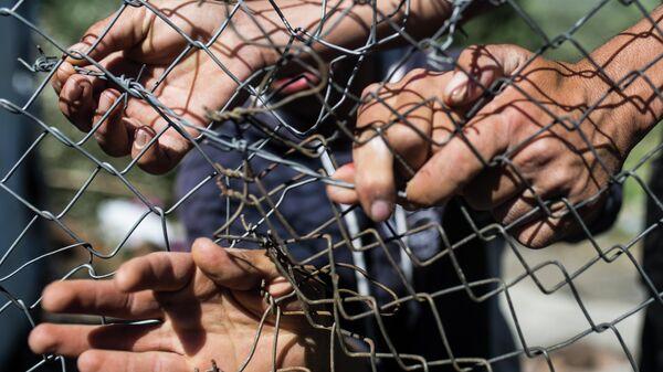 Мигранты в лагере беженцев Мориа в Греции