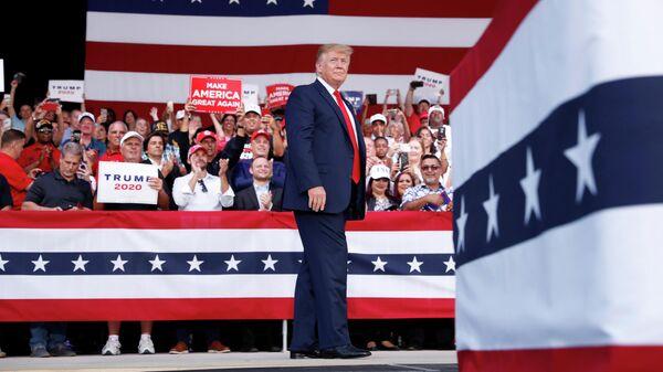 Президент США Дональд Трамп во время выступления перед своими сторонниками в Панама-сити. штат Флорида. 8 мая 2019