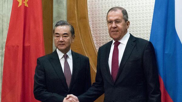 Министр иностранных дел России Сергей Лавров и министр иностранных дел Китая Ван И во время встречи в Сочи. 13 мая 2019