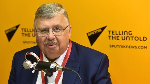 Председатель правления Евразийского банка развития Андрей Бельянинов в радиорубке Sputnik в конгрессно-выставочном центре Экспофорум на ПМЭФ-2019