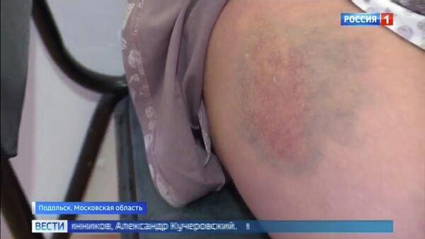 Кадр из сюжета телеканала Россия-1 об избиении в городе Подольске женщины, находящейся на 9-м месяце беременности