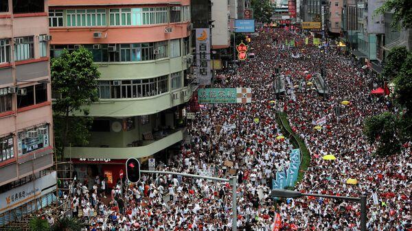 Демонстрация в Гонконг в знак протеста против поправки к законопроекту об экстрадиции. 9 июня 2019