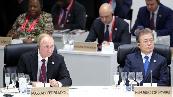 Президент РФ Владимир Путин на заседании глав делегаций государств – участников Группы двадцати. 28 июня 2019