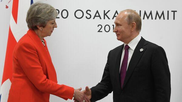 """""""Дайте їй вологу серветку"""": Мей під час рукостискання з Путіним показала своє ставлення до нього виразом обличчя - Цензор.НЕТ 8322"""