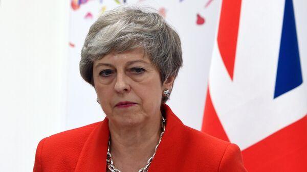 Премьер-министр Великобритании Тереза Мэй во время встречи с президентом РФ Владимиром Путиным на полях саммита Группы двадцати в Осаке. 28 июня 2019