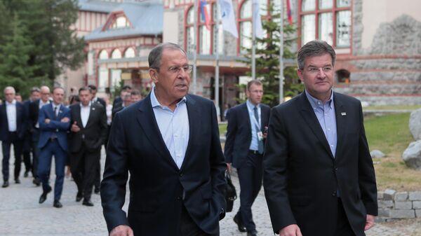 Министр иностранных дел РФ Сергей Лавров и министр иностранных дел Словакии Мирослав Лайчак во время неформальной встречи глав МИД стран-участниц  ОБСЕ