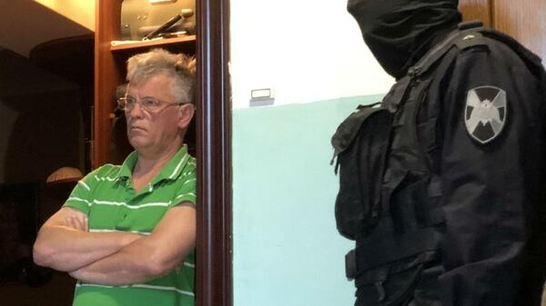 Исполняющий обязанности министра строительства и жилищно-коммунального хозяйства Астраханской области Олег Гужвинский во время задержания