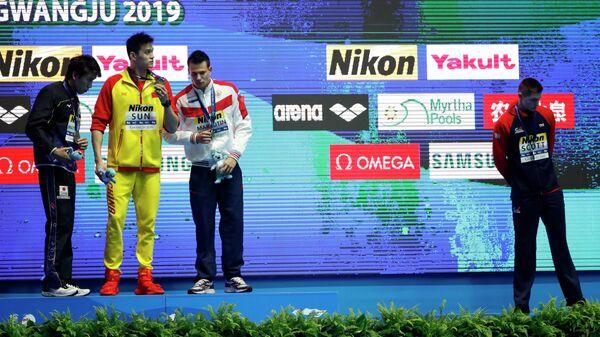 Британец Данкан Скотт отказался подняться на подиум к китайцу Сунь Яну, замешанному в допинг-скандале.