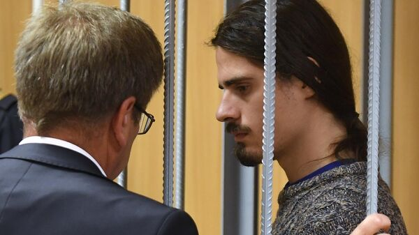 Иван Подкопаев, обвиняемый по уголовному делу о массовых беспорядках в центре Москвы 27 июля, во время рассмотрения ходатайства следствия об аресте в Пресненском суде Москвы