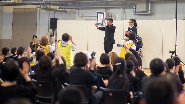 Выступление 289 человек в Японии с инструментом в виде матрешки вошло в книгу Гиннеса