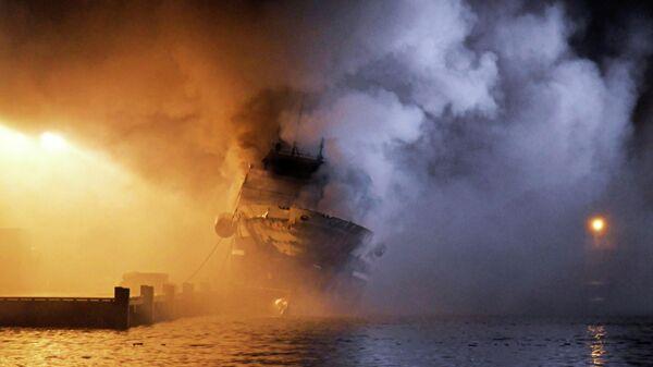 Тушение российского траулера Бухта Наездник в порту Тромсё, Норвегия