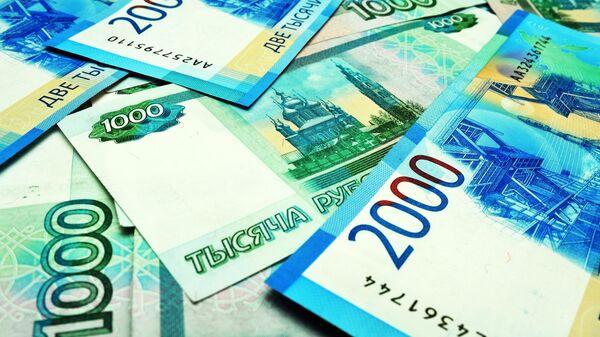 Банкноты номиналом 1000 и 2000 рублей