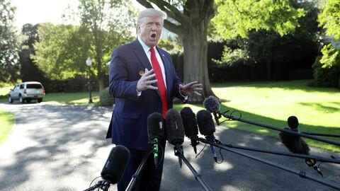 Президент США Дональд Трамп отвечает на вопросы журналистов на южной лужайке Белого дома в Вашингтоне