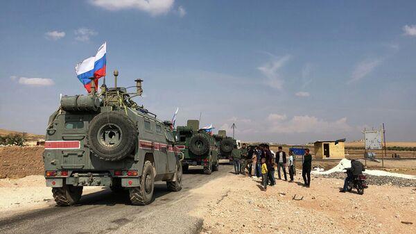Бронеавтомобили военной полиции РФ в районе Кобани на сирийско-турецкой границе