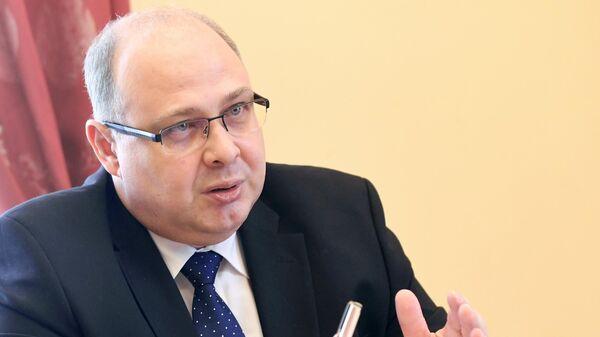 Директор Второго Европейского департамента МИД РФ Сергей Беляев во время интервью в Москве