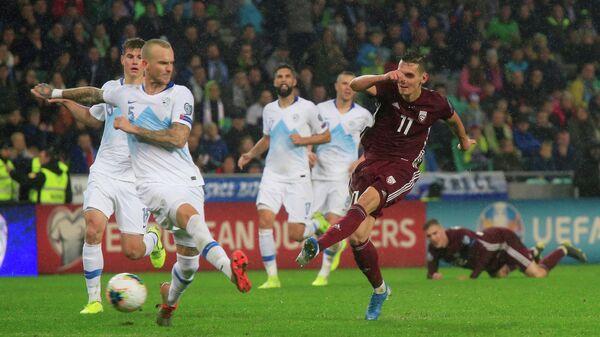Игровой момент матча Словения - Бельгия