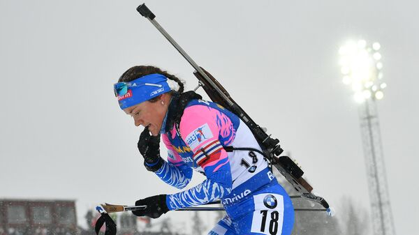 Екатерина Юрлова-Перхт (Россия) на дистанции масс-старта среди женщин на чемпионате мира по биатлону в шведском Эстерсунде.