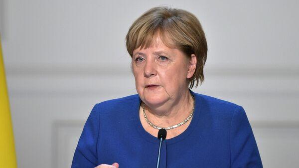 Федеральный канцлер Германии Ангела Меркель на пресс-конференции по итогам встречи в Нормандском формате в Елисейском дворце