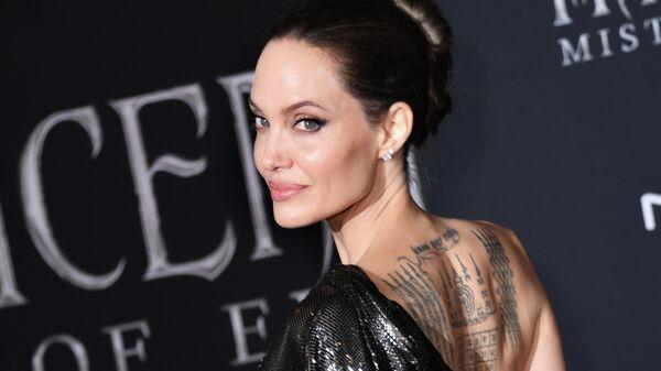 Анджелина Джоли на премьере фильма Малефисента: Владычица тьмы в Голливуде