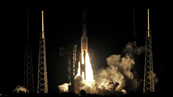 Новейший корабль Starliner на ракете-носителе Atlas V во время старта c мыса Канаверал во Флориде, США. 20 декабря 2019