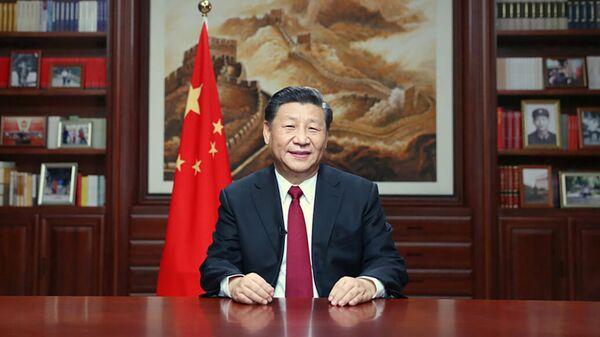 Председатель КНР Си Циньпин выступает с новогодним обращением