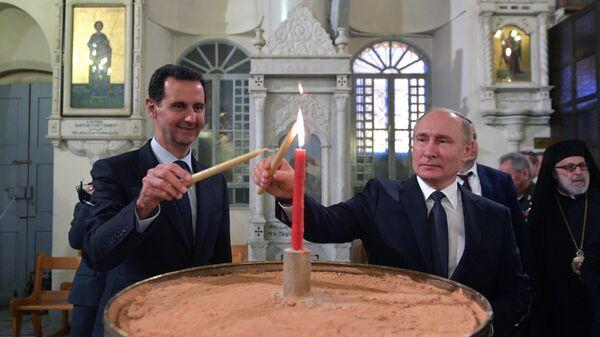 Президент Сирии Башар Асад и президент РФ Владимир Путин в кафедральном соборе Пресвятой Богородицы в Дамаске