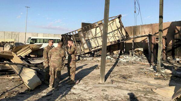 Последствия ракетного удара по авиабазе Айн аль-Асад на западе Ирака