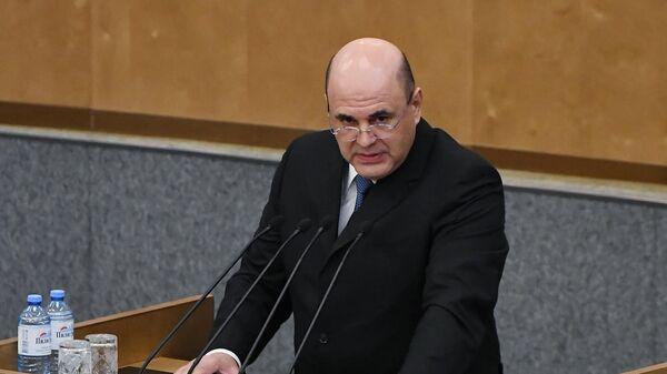 Кандидат на пост премьер-министра Российской Федерации Михаил Мишустин выступает на пленарном заседании Государственной думы