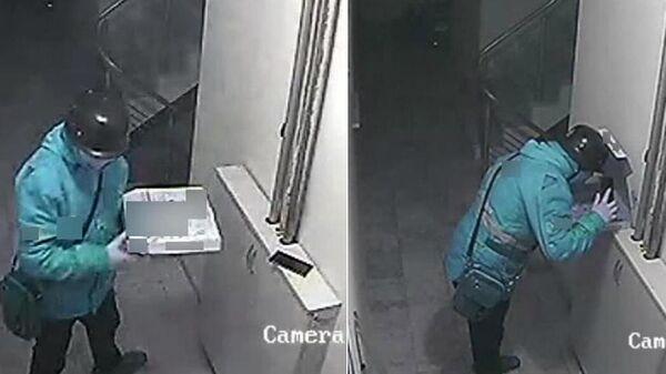 Стоп-кадр записи камеры видеонаблюдения, на которой работник службы доставки в Турции плюет в пиццу