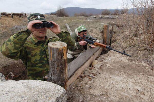Жители ЮО обеспокоены увеличением числа грузинских военных на границе