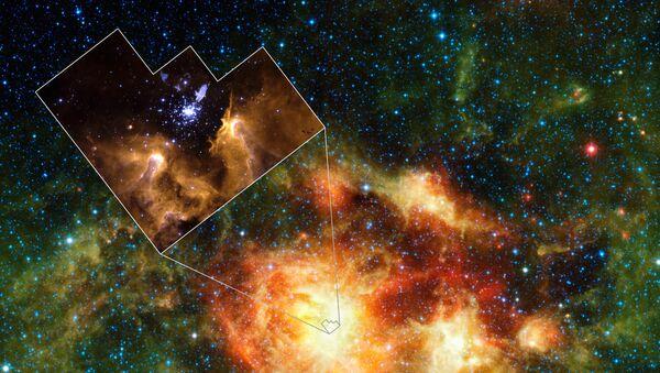 Область активного звездообразования в звездном скоплении NGC 3603. Снимок космического инфракрасного телескопа WISE