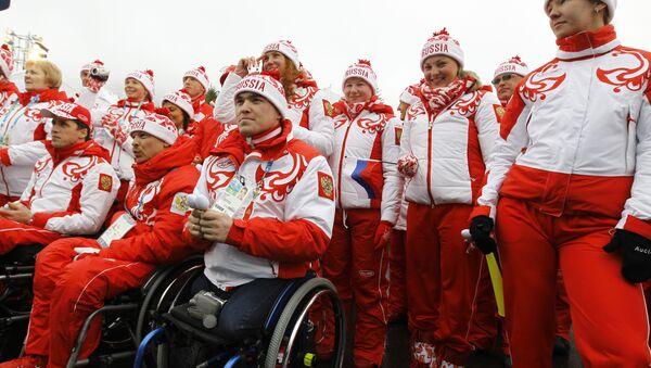 Церемония поднятия российского флага в Паралимпийской деревне