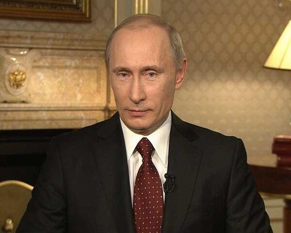 Владимир Путин во время интервью Ларри Кингу