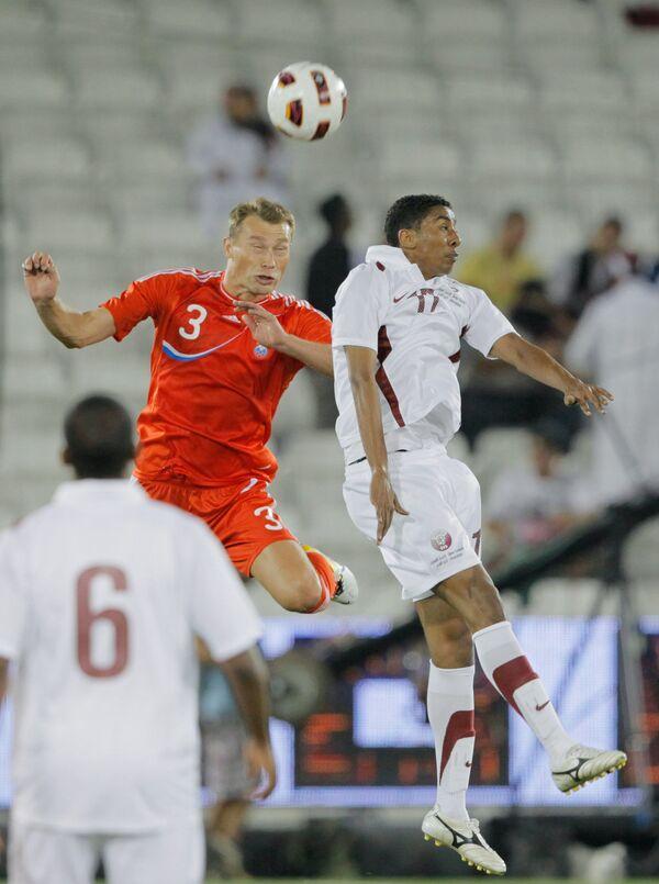 Игровой момент матча Катар - Россия
