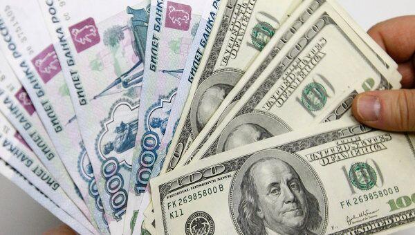 Очередное ослабление рубля не вызвало ажиотажа  - эксперты