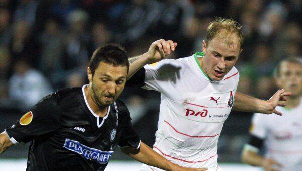 Игровой момент матча Штурм - Локомотив