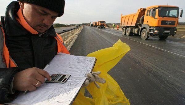 Строительство дороги, фото из архива