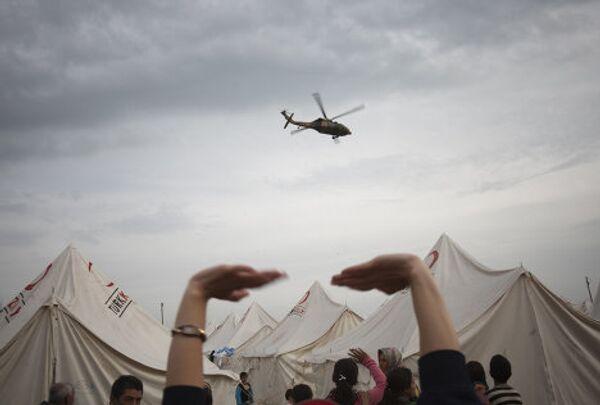 Помощь пострадавшим в результате землетрясения в турецкой провинции Ван