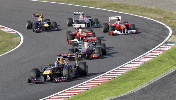Пилоты Формулы-1 на трассе. Архив