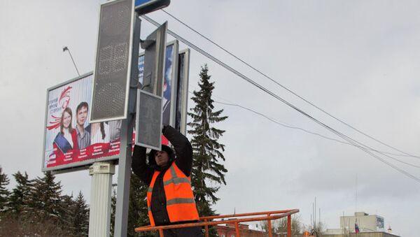 Ремонт светофора на улице