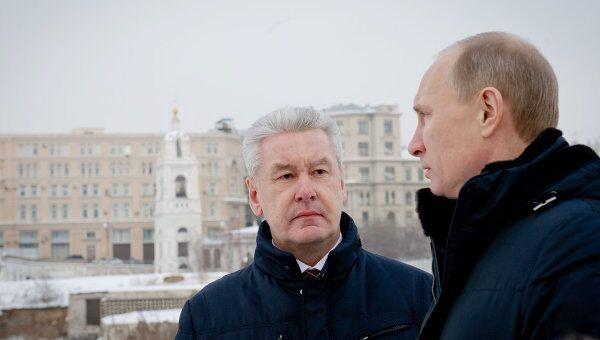 В.Путин и С.Собянин посещают место бывшей гостиницы Россия